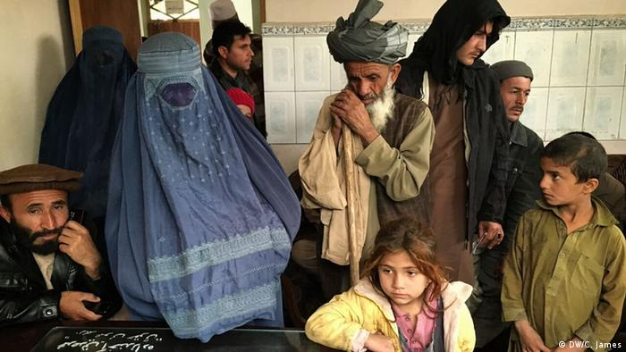 Sayed Nazin, who is blind, accompanies his wife and the two youngest of his four children to the Kunduz provincial department of the Ministry of Refugees and Repatriation to apply for government assistance. They fled to Takhar province during the fighting