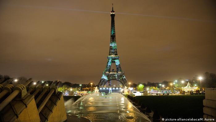 Eifel tower iluminated with green lights