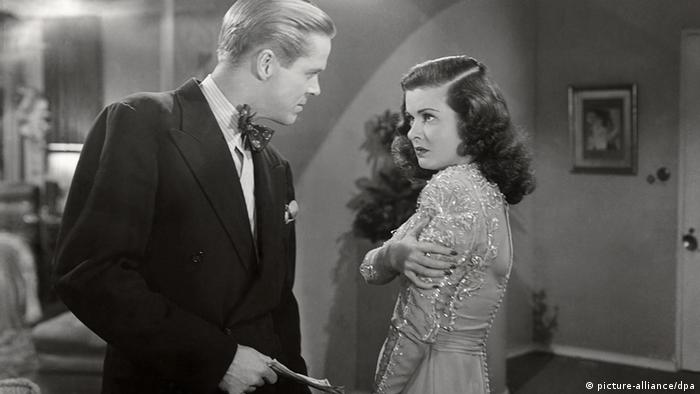 Film still 'The Woman in the Window': a domestic scene with actors Dan Duryea and Joan Bennett