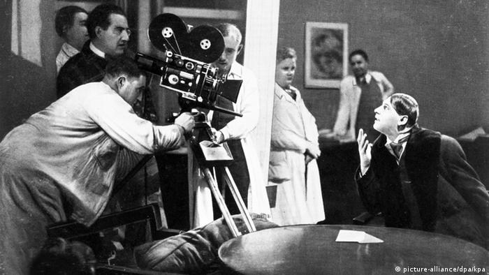 Film set photo of Fritz Lang shooting 'Woman in the Moon'