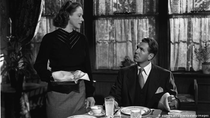 Film still 'Secret Beyond the Door': a scene at a dinner table with actors Anne Revere and Michael Redgrave.