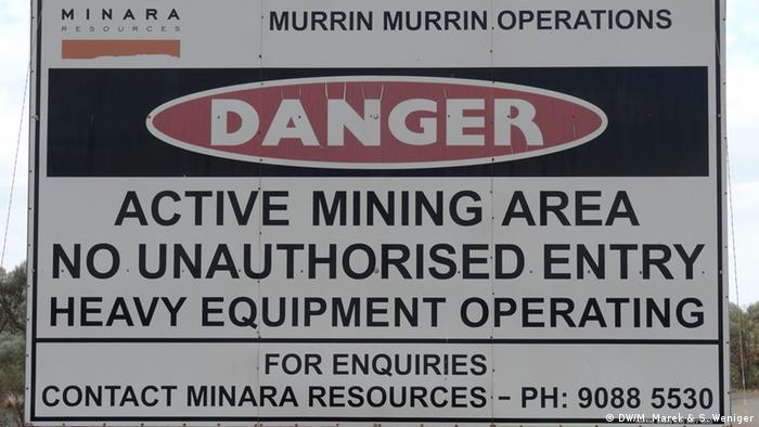 A warning sign cautioning unauthorized people from entering a mining area