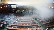 epa05049361 Opposition lawmakers throw tear gas during a session of Kosovo's parliament in Pristina, Kosovo, 30 November 2015. Opposition lawmakers used tear gas at the start of the parliament session to protest against the agreements that Kosovo's government reached during the EU-brokered dialogue with Serbia. EPA/PETRIT PRENAJ picture-alliance/dpa/P.Prenaj