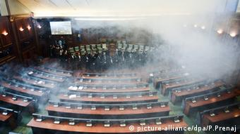 Opposition lawmakers throw tear gas during a session of Kosovo's parliament