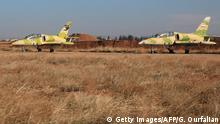 Syrian air forces jets are seen at the Kweyris military air base, in the northern Syrian province of Aleppo, on November 11, 2015. Syria's army broke a more than year-long jihadist siege of the military air base in the country's north, scoring its first major breakthrough since Russia's air campaign began. AFP PHOTO / GEORGE OURFALIAN (Photo credit should read GEORGE OURFALIAN/AFP/Getty Images) +++(C) Getty Images/AFP/G. Ourfalian
