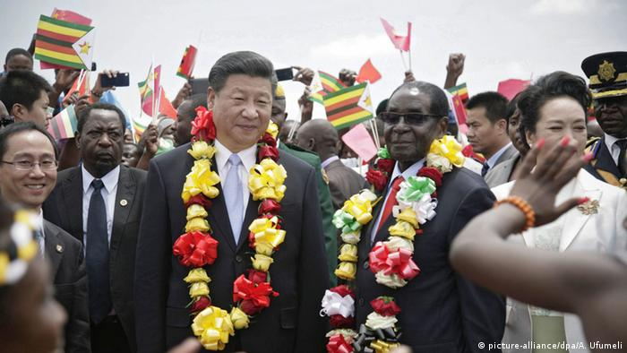 Chinese President Xi Jinping with Zimbabwean President Robert Mugabe in Harare in 2015