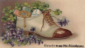 This postcard from the 19th century depicts the Dutch tradition of filling shoes with goodies for Sinterklaas, Copyright: Postcard courtesy of St. Nicholas Center