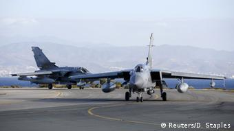 Two British Tornados taxi on the runway, after returning from a mission, at RAF Akrotiri