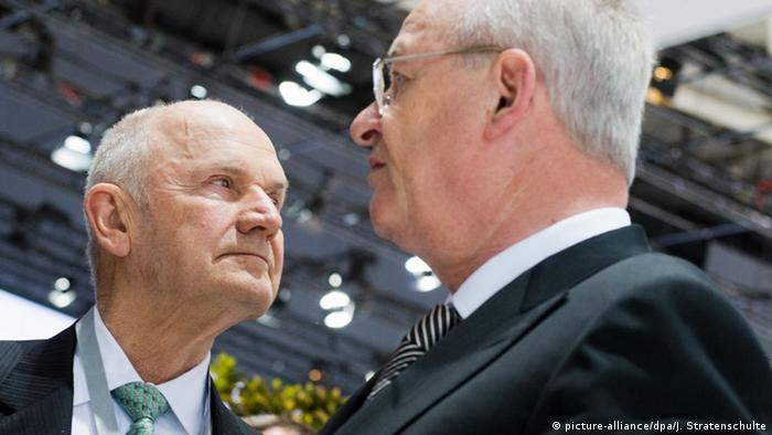 Ferdinand Piech speaks with Martin Winterkorn at the start of a VW shareholder's meeting in Hanover in 2013