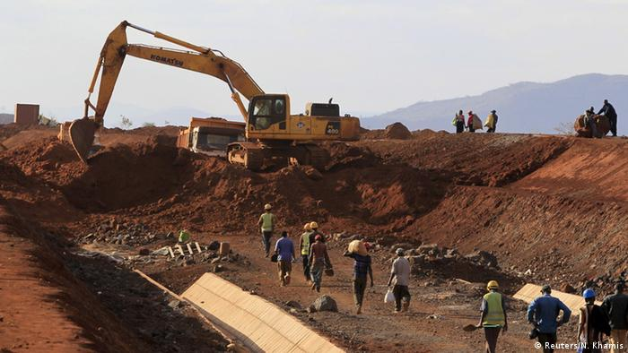 Heavy machines and workers at the site of a railway line in Kenya