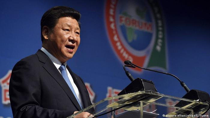 President Xi Jinping of China speaking from a podium