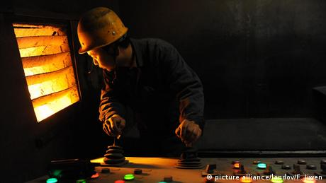 A man working in a riding in steel factory in Beijing