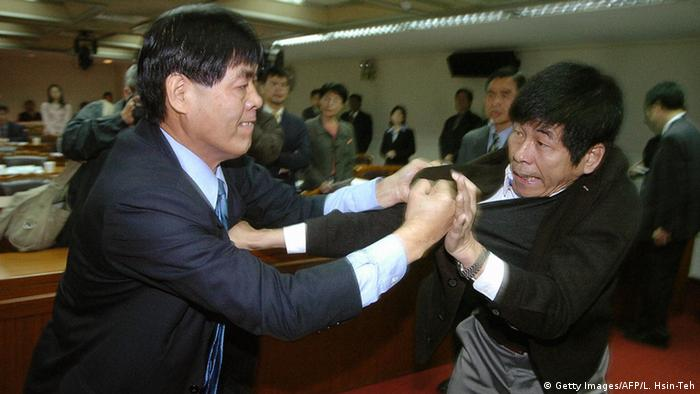 Taiwanese lawmakers engage in a fist-fight.