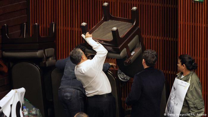 Mexican deputies from the Democratic Revolution Party (PRD) attempt to block one of the entrances to Congress