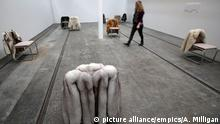 Turner Prize exhibition 2015. A visitor views an exhibit titled Infrastruktur by Turner Prize 2015 nominee Nicole Wermers at Tramway in Glasgow, which is hosting the first ever presentation in Scotland of the Turner Prize - the UK's most prestigious visual art award. Picture date: Wednesday September 30, 2015. See PA story ARTS Turner. Photo credit should read: Andrew Milligan/PA Wire URN:24288272 picture alliance/empics/Andrew Milligan