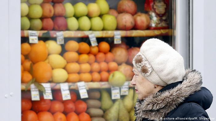 Russian woman in front of grocery store