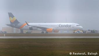A Condor airplane stands on a tarmac in Budapest, after a bomb threat forced it to make an emergency landing.