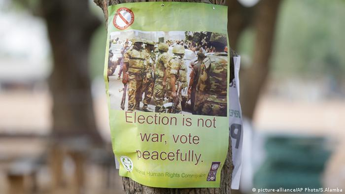 A poster attached to a tree in Nigeria reads 'Election is not war, vote peacefully'