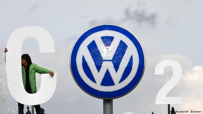 Greenpeace activists spell CO2 using VW's logo outside the company's headquarters in Wolfsburg, Germany