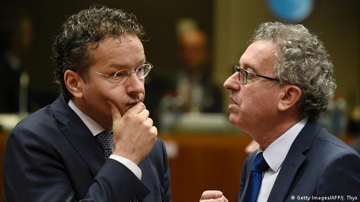 Dutch Finance Minister and Eurogroup president Jeroen Dijsselbloem listens to Luxembourg's Finance Minister Pierre Gramegna during a meeting in Brussels
