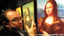 ARCHIV 2009 **** Bildunterschrift:French engineer and founder of Lumiere Technology, Pascal Cotte explains his work in the 'Secrets of the Mona Lisa' section during a press view of the 'Da Vinci � The Genius' exhibition at The Museum of Science and Industry (MOSI) in Manchester, north-west England, on November 12, 2009. The exhibition features images of the iconic painting, showing how Cotte looked through layers of accumulated varnish to see the original surface. The exhibition opens on November 14. AFP PHOTO/PAUL ELLIS (Photo credit should read PAUL ELLIS/AFP/Getty Images)
