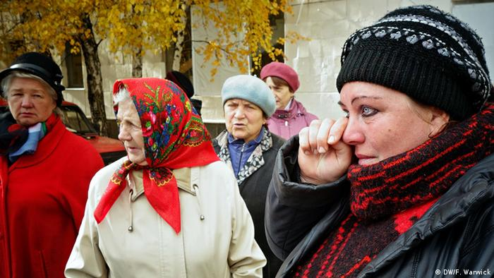 Vera Mihailova Kopeinika waits in line with others to register with the WFP