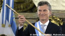 Argentine President Mauricio Macri, already wearing the presidential sash and staff, poses during his inauguration at the Casa Rosada government palace in Buenos Aires on December 10, 2015. Macri's inauguration marks the start of a new era for Argentina: a tilt to the right after 12 years under Kirchner and her late husband Nestor, the left-wing power couple that led the country back to stability after an economic meltdown in 2001. AFP PHOTO/JUAN MABROMATA / AFP / JUAN MABROMATA (Photo credit should read JUAN MABROMATA/AFP/Getty Images)