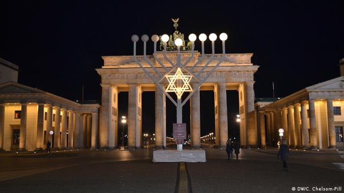 A giant menorah stands in front of Berlin's Brandenburg Gate