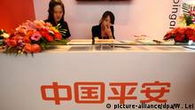ARCHIV 2011 *** --File--Chinese staff are seen at the stand of Ping An of China during a financial fair in Shanghai, China, 18 November 2011. China Ping An Trust, one of the largest insurers in China, is reportedly planning to invest in structured notes issued by Goldman Sachs and linked to the unlisted shares of social networking giant Facebook. The deal would see Ping An use QDII (qualified domestic institutional investor) products - which allow Chinese firms to invest in foreign securities markets - to put funds in private equity linked to Facebook. Earlier this month, an investor received an unexpected New Years gift from Ping An: fundraising information about a QDII structured product linked to Facebooks unlisted equity. He purchased private equity shares in Facebook, which is planning a much-anticipated US$10 billion IPO. Fundraising for the QDII trust products may be held after the Chinese New Year holiday, according to the Guangzhou-based 21st Century Business Herald. picture-alliance/dpa/W. Lei