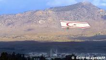 NICOSIA, CYPRUS: Self-declared Turkish Republic of Northern Cyprus flag is situated on the five finger mountains in the Turkish part of Nicosia, 04 March 2004. in the divided Mediterranean island of Cyprus.Turkish Cypriot leader Rauf Denktash arrived to Turkish capital Ankara for one-day visit. Hundreds of supporters - members of several parties from across the political spectrum- were waiting for Turkish Cypriot leader Rauf Denktash at the airport to voice their backing. Cyprus is Turkish and it will stay Turkish. Holds on Denktash, wake up Turkey , chanted the demonstrators. We will not leave Cyprus to Greek Cypriots , read one of their banners. A three kilometre-long ( nearly two mile ) queue of vehicles, draped in flags of Turkey and Denktash' self-styled Turkish Republic of Northern Cyprus ( TRNC ), formed along the road outside airport, 04 March 2004. Copyright: Getty Images/AFP