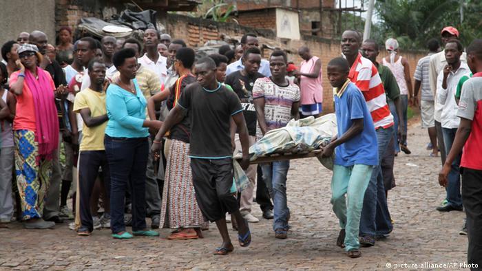 Burundians carry a dead bod