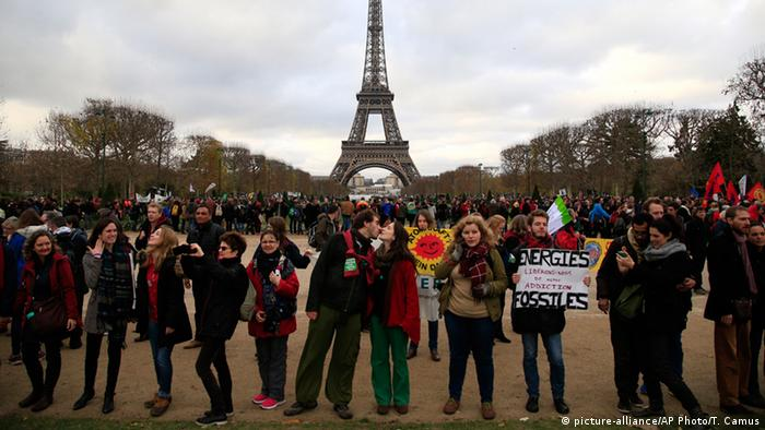 Pro-climate demonstrators at the Eiffel Tower during COP21 in Paris