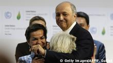 12.12.2015 *** Bildunterschrift:Foreign Affairs Minister and President-designate of COP21 Laurent Fabius (R) hugs French Ambassador for the international Climate Negotiations Responsible for COP21 Laurence Tubiana, as Executive Secretary of the United Nations Framework Convention on Climate Change (UNFCCC) Christiana Figueres (L) looks on after adoption of a historic global warming pact at the COP21 Climate Conference in Le Bourget, north of Paris, on December 12, 2015. Envoys from 195 nations on December 12 adopted to cheers and tears a historic accord to stop global warming, which threatens humanity with rising seas and worsening droughts, floods and storms. AFP PHOTO / FRANCOIS GUILLOT / AFP / FRANCOIS GUILLOT (Photo credit should read FRANCOIS GUILLOT/AFP/Getty Images) Copyright: Getty Images/AFP/F. Guillot