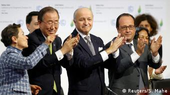 Climate Agreement is celebrated by world leaders in Paris.