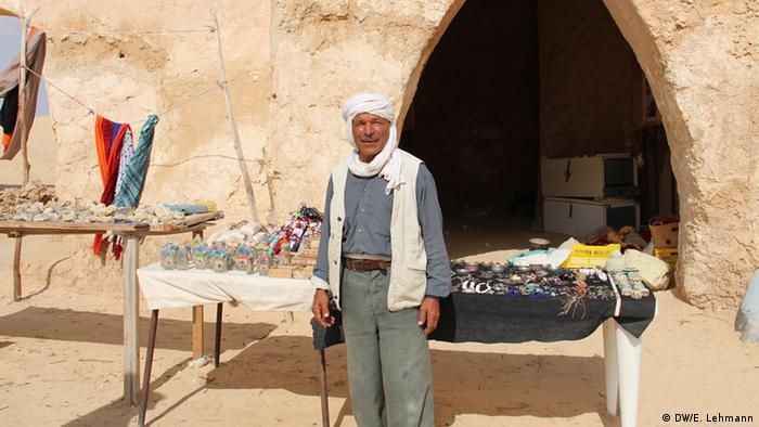 Vendor outside a cave-like structure (Copyright: E Lehmann)