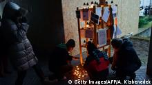 Local young people light candles on the last day of the eight-day Jewish festival of lights, the Hanukkah, at Bartok square of Szekesfehervar town, southwest of Budapest, on December 13, 2015, as a protest besides the covered statue base of a planned statue in honor of Balint Homan who participated as Hungarian minister during the World War II era in drafting legislation that restricted the rights of Hungarian Jews and called for their deportation. On March 6, 2015, the Budapest Municipal Court rehabilitated Balint Homan, who had been sentenced to life imprisonment by the post-war Peoples Court in 1946. Copyright: Getty Images/AFP/A. Kisbenedek