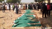 ARCHIV 2014 *** Shiite community members gather on November 4, 2014 for funeral rites of members killed on November 3 during a procession at a Shiite festival in Potiskum, Yobe state. A suicide bombing at a Shiite ceremony killed at least 15 people in northeastern Nigeria on November 3. The attack in Potiskum, the commercial capital of Yobe state, targeted Shiite Muslims marking Ashura, the anniversary of the death of Hussein, the grandson of the Prophet Mohammed. AFP PHOTO/STRINGER (Photo credit should read -/AFP/Getty Images) Getty Images/AFP