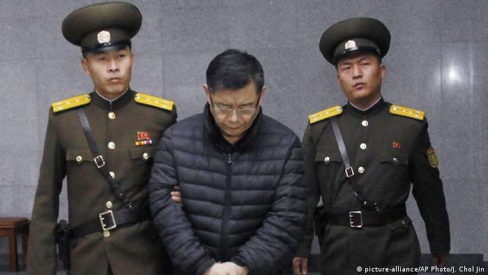 Hyeon Soo Lim, center, who pastors the Light Korean Presbyterian Church in Toronto, is escorted to his sentencing in Pyongyang, North Korea, Wednesday, Dec. 16, 2015 (AP Photo/Jon Chol Jin)