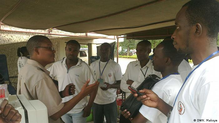 Students in Tanzania listening to an instructor