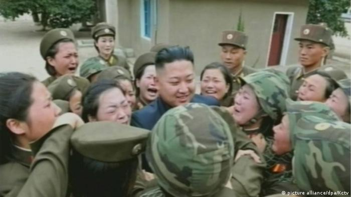 Kim Jong Un surrounded by crying female soldiers (picture alliance/dpa/Kctv)