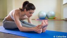 Bildergalerie Yoga Young pretty girl stretching legs. Yoga workout Colourbox