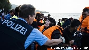 police helping refugees copyright: DIMITAR DILKOFF/AFP/Getty Images