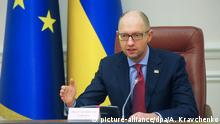 18 December 2015 epa05073918 Ukrainian Prime Minister Arseniy Yatsenyuk speaks during his cabinet meeting in Kiev, Ukraine, 18 December 2015. Ukraine has imposed a moratorium against paying back 3 billion dollars that it borrowed from Russia in late 2013, Ukrainian Prime Minister Arseniy Yatsenyuk told his cabinet of ministers. Relations between Russia and Ukraine sank to an all-time low in 2014, when Ukraine ousted its pro-Russian president during mass protests calling for closer ties with the West. Russia subsequently occupied and annexed Ukraine's southern Crimea region and supported a pro-Russian separatist rebellion in Ukraine's two eastern-most regions. +++picture-alliance/dpa/A. Kravchenko