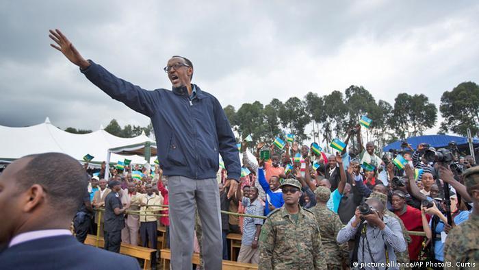 Rwanda's president Paul Kagame waves to crowds