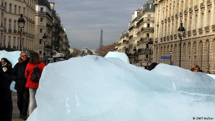 Giant ice blocks in central Paris. The Eiffel Tower in the distance