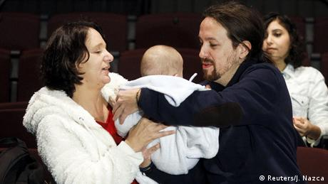 Podemos party members in the Spanish parliament. The baby is the child of Carolina Bescansa, a Podemos MP.