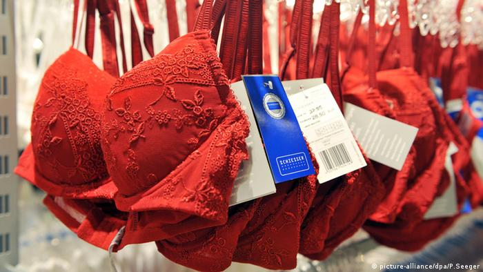 A series of red bras on hangers