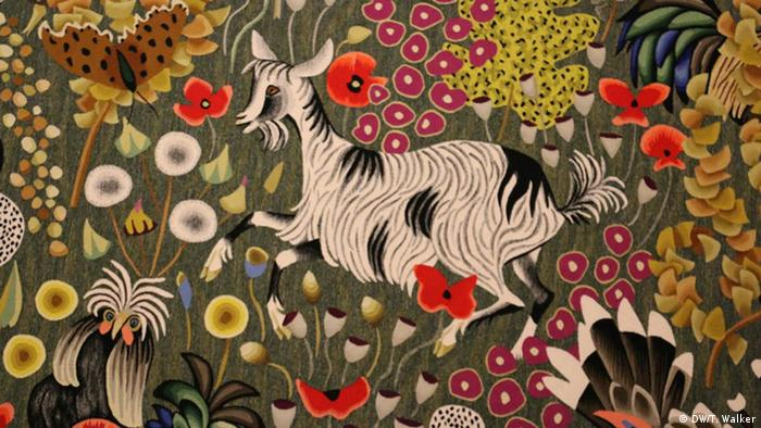 Tapestry of a goat in a meadow of flowers
