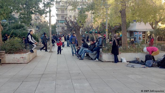 people sitting, standing in a square copyright: Pavlos Zafiropoulos