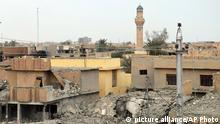 Buildings are damaged in Ramadi as Iraqi security forces, supported by U.S.-led coalition airstrikes, advance their positions towards the central Ramadi, 70 miles (115 kilometers) west of Baghdad, Iraq, Thursday, Dec. 25, 2015. The advance of government forces in the Islamic State-held city of Ramadi is being hampered by suicide bombers, snipers and booby traps, Gen. Ismail al-Mahlawi, the head of Iraqi military operations in Anbar said. (AP Photo)